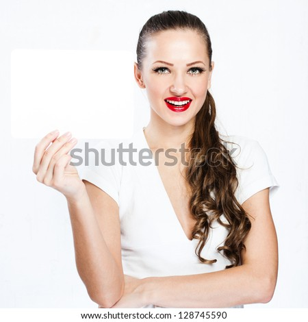 young smiling woman holding blank business card - stock photo