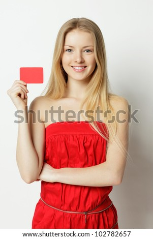 Young smiling woman holding credit card