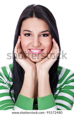 Young smiling woman holding her head in hands