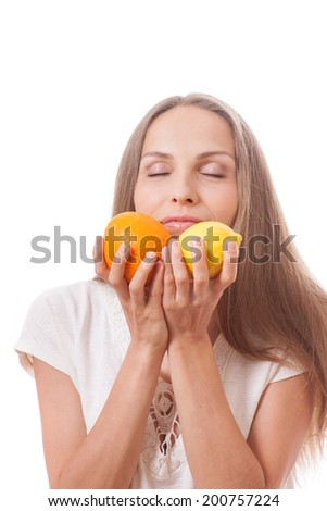 young smiling woman holding  orange and lemon