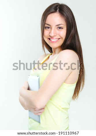 young smiling woman holding tablet computer. isolated over white background. girl using new technologies wireless computer.