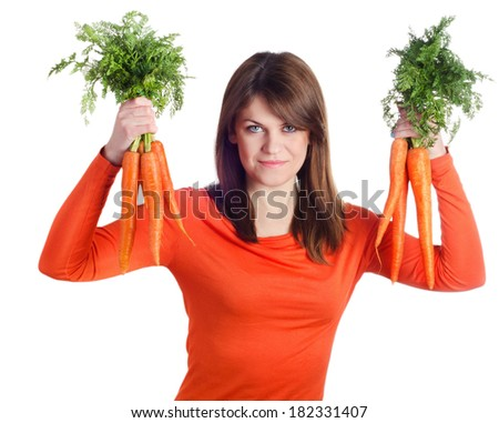 Young smiling woman holds healthy food - bunch of carrots