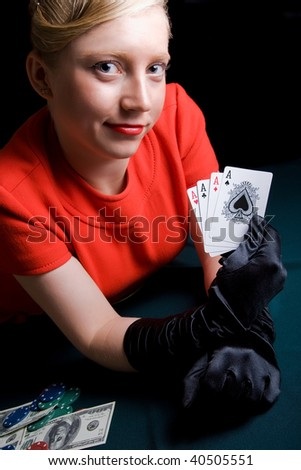 Young smiling woman holds playing cards - stock photo