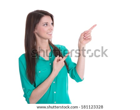 Young smiling woman in green blouse presenting with her forefinger. - stock photo
