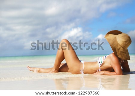 young smiling woman in summer hat on tropical sea background - stock photo
