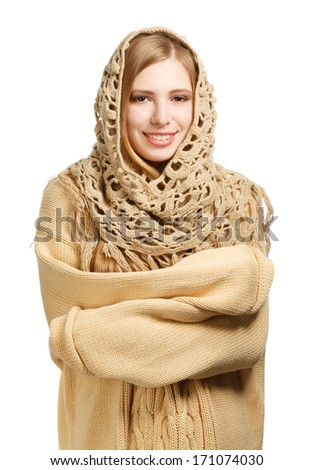 Young smiling woman in warm comforter standing isolated on white background - stock photo