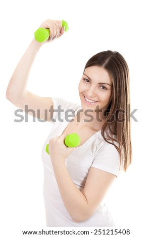Young smiling woman in white t-shirt trains biceps lifting dumbbell weights, workout, doing fitness exercises. Isolated on white background - stock photo