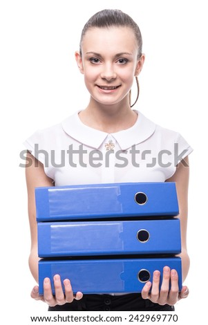 Young smiling woman is holding folders isolated over a white background. - stock photo