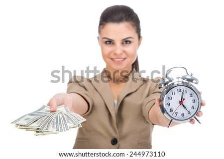 Young smiling woman is holding in hand a lot american dollars and clock isolated on white background. - stock photo