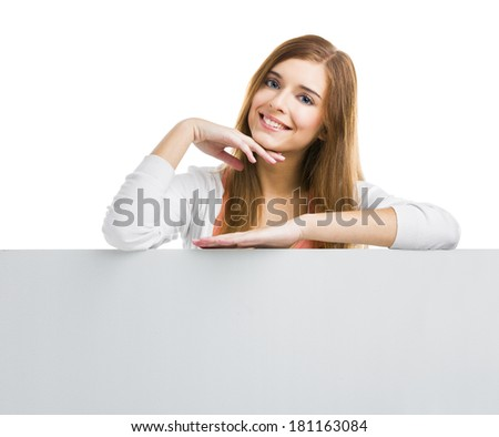 Young smiling woman leaning on a big blank board, isolated over white background - stock photo
