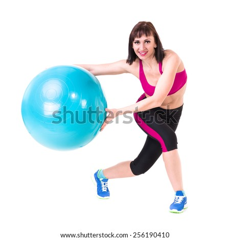 Young smiling woman makes exercise with fitball, full length portrait isolated over white background - stock photo