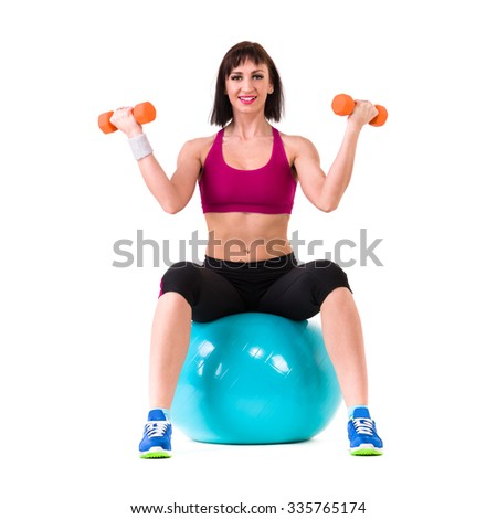 Young smiling woman makes exercise with fitball, full length portrait isolated over white background