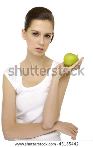Young smiling woman offering a green apple