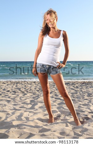 young smiling woman on beach background - stock photo