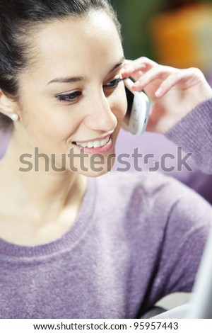 young smiling woman on phone