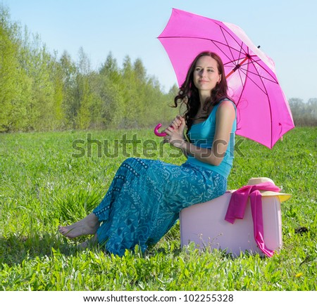 Young smiling woman outdoor in summer - stock photo