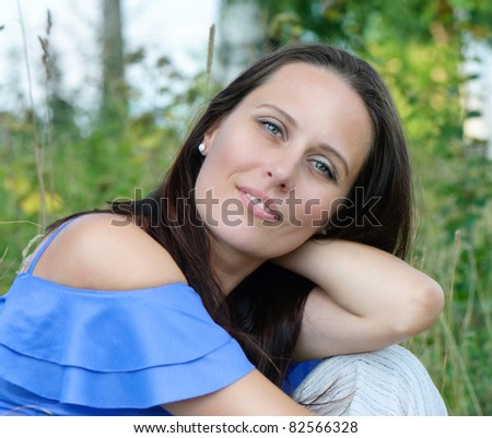Young smiling woman outdoor in summer