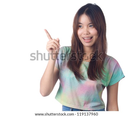 Young smiling woman pointing  to copyspace in casual jeans on white background