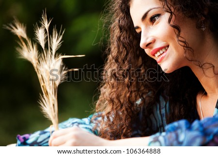 young smiling  woman portrait enjoy in  nature summer day - stock photo