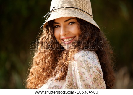 young smiling woman portrait with hat outdoor summer day - stock photo