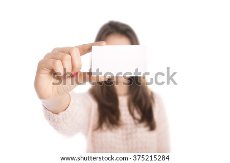 Young smiling woman show blank card - stock photo