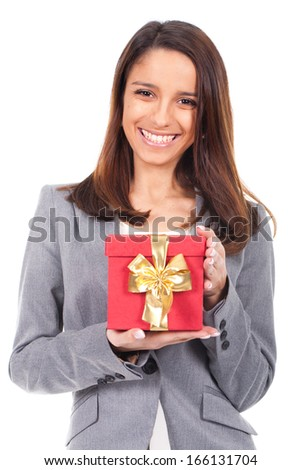 young smiling woman showing a Gift - stock photo