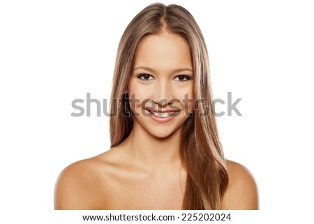 Young smiling woman with beautiful healthy face on white background - stock photo