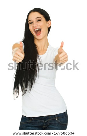 Young smiling woman with blank white t-shirt holds her thumbs up isolated on white background. Woman showing thumbs up sign. Focus on the face - stock photo