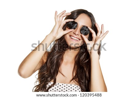 young smiling woman with candy on eyes, funny expression. on white background - stock photo