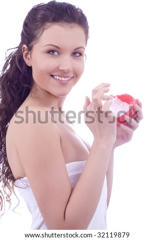 young smiling woman with cream in hands - stock photo