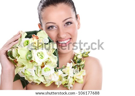 Young smiling woman with flowers - stock photo