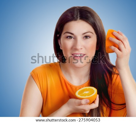 Young smiling woman with fresh orange