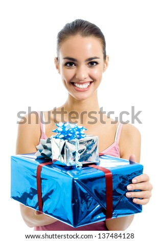 Young smiling woman with gifts, isolated over white background - stock photo