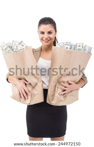 Young smiling woman with paper bags full of money, isolated on white background. - stock photo