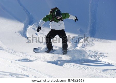 Young Snowboarder having fun with powder snow