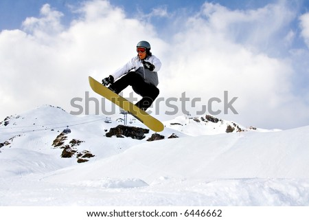 Young Snowboarder Jumping high over the snow