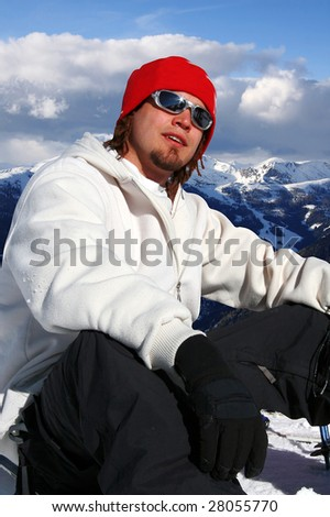 young snowboarder relaxing - stock photo