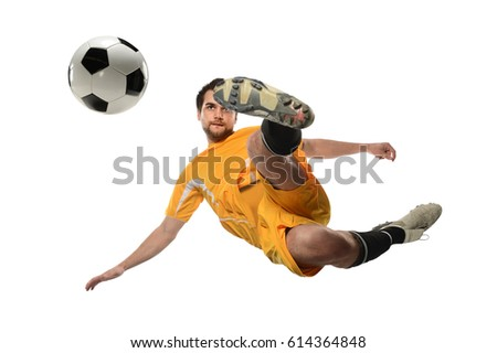 Young soccer player kicking ball in midair isolated over white background