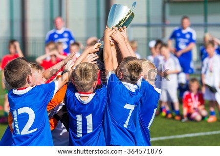 Young Soccer Players Holding Trophy Boys Stock Photo (Edit ...