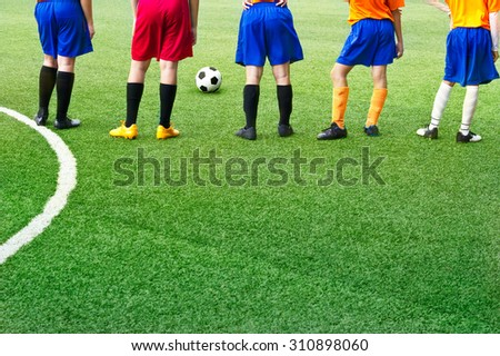 Young soccer players in field soccer academy - stock photo