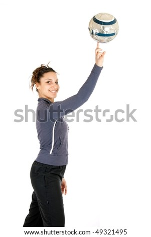 young soccer woman making ball rolling on finger