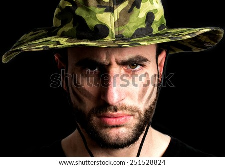 Young soldier against black background - stock photo