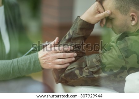 Young soldier suffering from depression after war - stock photo