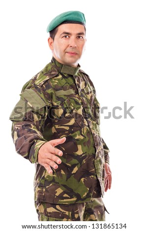 Young soldier with hand outstretched for a handshake isolated on white background
