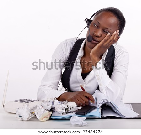 Young South African woman overwhelmed by work and boredom - stock photo