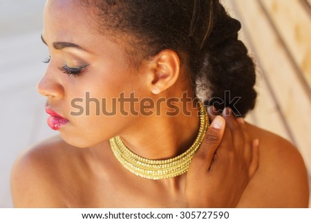 Young south african zulu woman is wearing jewelry - stock photo