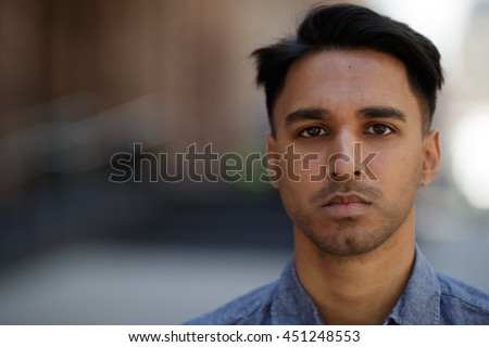 Young southeast Asian man in New York City serious face portrait