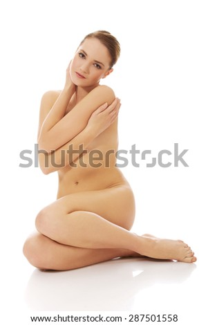 Young spa woman sitting on the floor. - stock photo