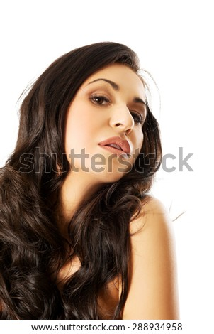 Young spa woman with beautiful long hair.