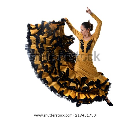 young spanish woman dancing Sevillanas wearing typical folk gold and black  tailed gown dress in flamenco traditional dance of Spain concept isolated on white background - stock photo